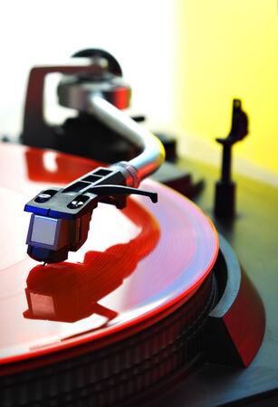 turntable - needle on coloured vinyl disc photo