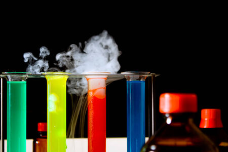 liquids: laboratory scene with test tubes, filled with colorful liquids, steaming