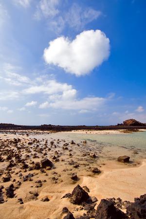 heart-shaped cloud over the island of Los Lobos, near Fuerteventura photo