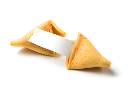 a broken fortune cookie isolated on white with blank message strip photo