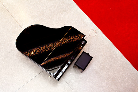 Grand piano, seen from above, next to red carpet Stock Photo