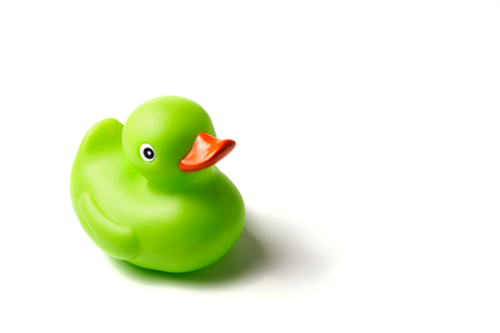ducky: green rubber ducky, white background Stock Photo