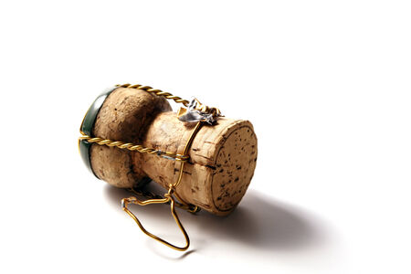 champagne cork with golden wire and green top photo