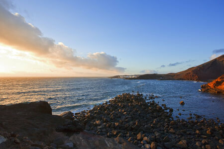 the village of El Golfo, Lanzarote and the bay at sunset Stock Photo - 29443409