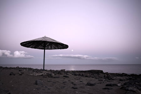 Lanzarote beach, straw sunshade in moonlight Stock Photo - 29443413