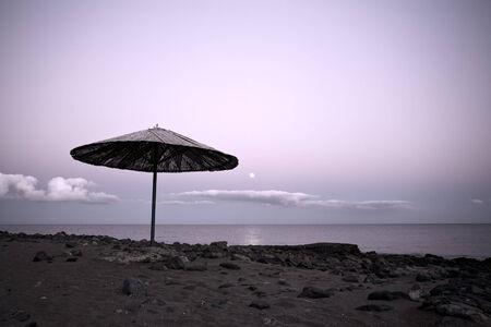 Lanzarote beach, straw sunshade in moonlight Stock Photo - 29443413