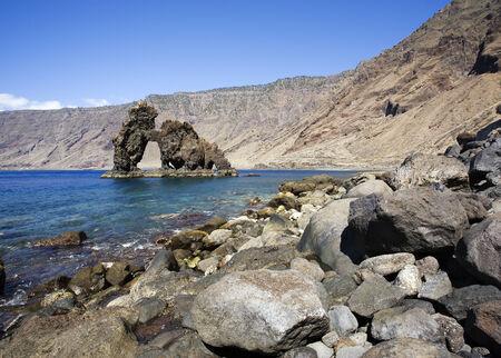 bonanza: the stone arch Roque de Bonanza at El hierro coast, washed out by the sea