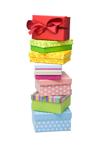 top seven: seven colorful gift boxes stacked, red box with lanyard on top, isolated on white