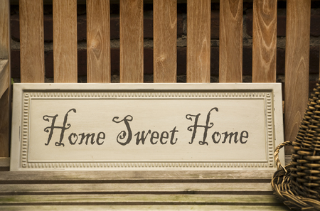 sign saying Home Sweet Home at flea market stand