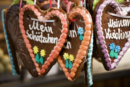 various german gingerbread hearts at Oktoberfest, one saying My little treasure,  photo
