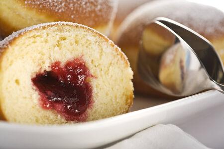 marmelade filled bismarck doughnuts close-up photo