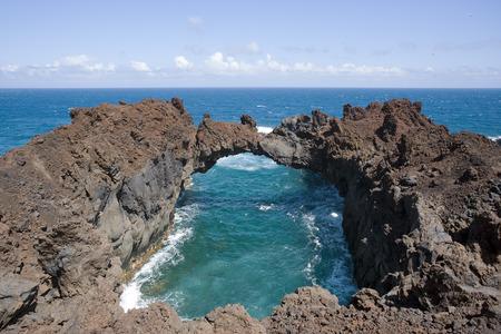 Arco de la Tosca, the stone arch at western coast of El Hierro Stock Photo