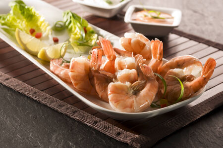 gambas: fried black tiger prawns on plate with salad garnish and dip sauces Stock Photo