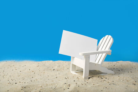 adirondack: blank price tag on white beach chair miniature in sand Stock Photo
