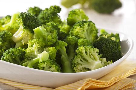 broccoli: Steamed broccoli in a bowl close up