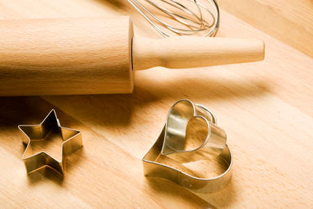 whisker: cookie cutters, whisker and rolling pin on wooden board