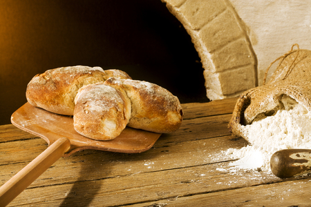 taking swiss bread from the oven