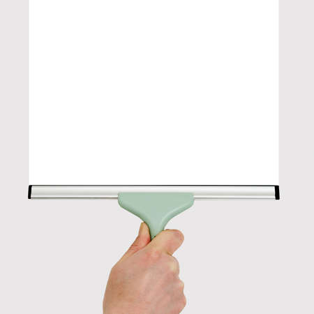 squeegee: hand with squeegee making gray background white Stock Photo