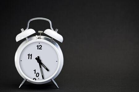 classic white double bell alarm clock, numbers\ vanishing