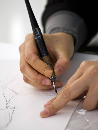 hands of a manga artist drawing Stock Photo