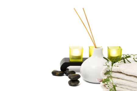 incense sticks: wellness and aromatherapy still-life with incense sticks, towels, flower, massage stones, candles