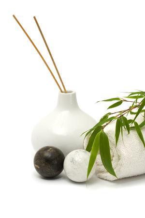 qigong: asian wellness still-life with qi-gong balls, incense sticks in vase, towel, bamboo branch, isolated on white