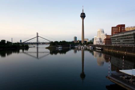 rhine westphalia: dusseldorf mediaharbor, rhine tower, marina and bridge in the evening
