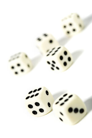 tilted view: six dice on white background, selective focus, tilted view