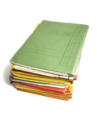 heap of file folders isolated on white photo