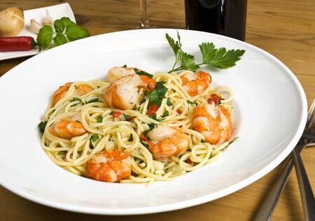 scampi: spaghetti with scampi, garlic and chili on a plate