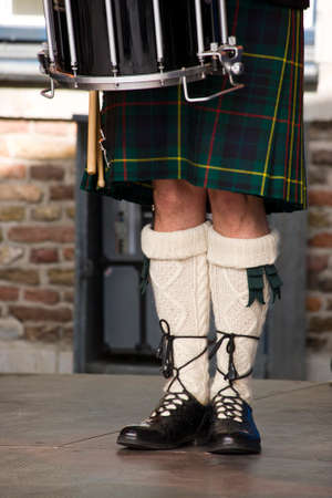 scot: legs of scottish drummer in traditional clothing
