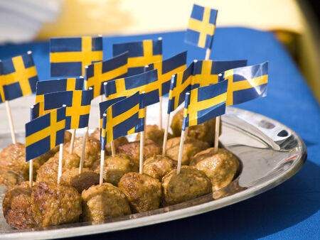meatballs with swedish flags on toothpicks photo