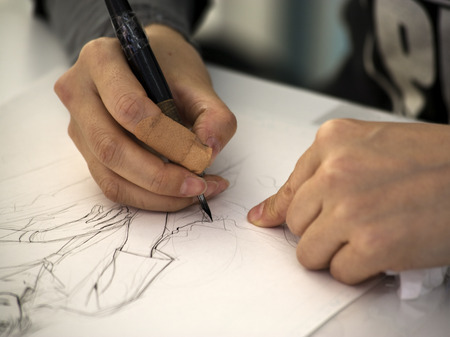 hands of a manga artist drawing a sketch Stock Photo
