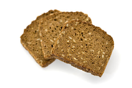 bove: three slices of whole grain brown bread froma bove, shallow depth of field, isolated on white Stock Photo