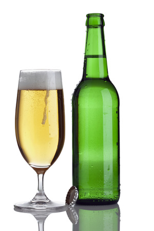 pilsener: green bottle and glass with fresh pilsener beer isolated on white