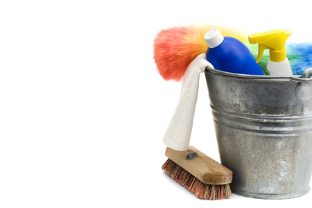cleaning supplies - bucket, spray bottle, detergent, rug, scrubber, duster - isolated on white