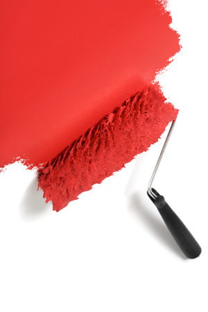 paint roller turning white background into red photo
