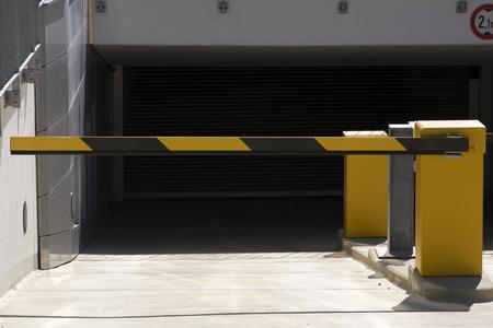 subterranean: yellow barrier at subterranean car park entranceexit