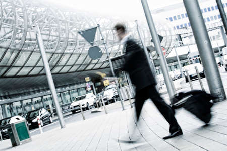 businessman with trolley at the airport, motion blurred photo