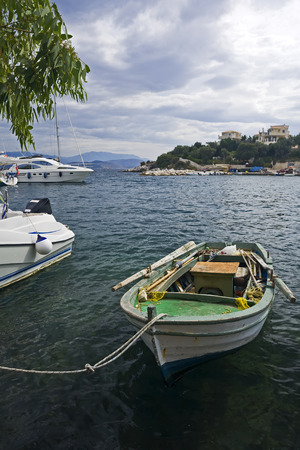towed: small fisherboat towed at bay of Kassiopi, Corfu, Greece