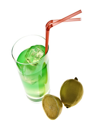 longdrink: green longdrink with ice and straws, whole and half lemon, backlit, tilted angle, shallow depth of field