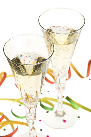 celebration champagne: two glasses of champagne with new years eve decoration, shallow depth of field
