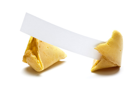 broken fortune cookie, blank message slip in one part, white background photo