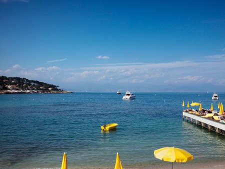 sunshades: bay at Cap dAntibes with yellow sunshades