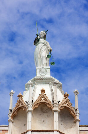 justitia: Justitia, goddess of justice on topof the Doges palace at Venice, Italy Stock Photo