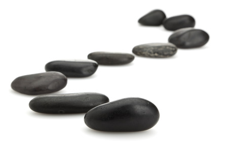 s-curve shaped path of stones on white background