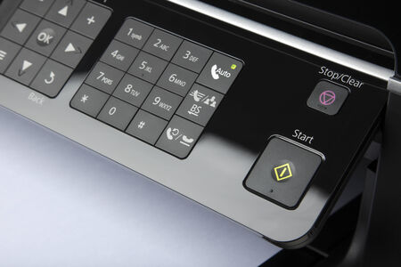 numers: detail of fax machine with number pad and start button