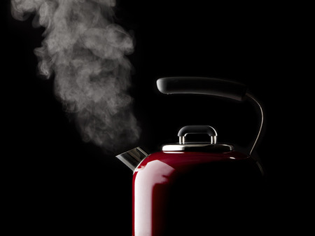 boiling: vapor coming from red kettle