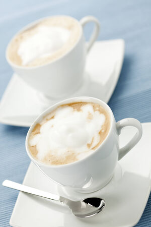 tilted view: two cups of cappucccino, tilted view Stock Photo