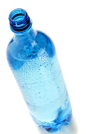 tilted view: blue bottle of mineral water with dew drops, tilted view  Stock Photo